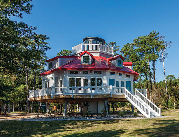 "Rick Andrews has now developed a ""screw-pile"" (hexagonal structures on pilings) lighthouse home and implemented unique construction procedures to protect it from hurricane damage."