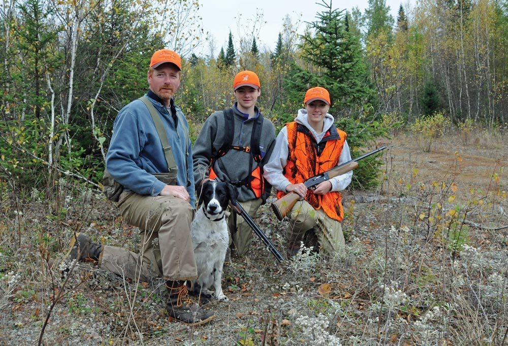 father and kids on a maine upland bird hunting trip